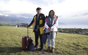 Chinese tourists Xiaolei Chen and Jiangyong are honeymooning in New Zealand. They were evacuated by the Chinese consulate.