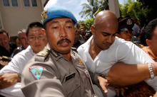 A 2006 file photo shows Myuran Sukumaran (left) and Andrew Chan arriving at Denpasar Court to be sentenced.