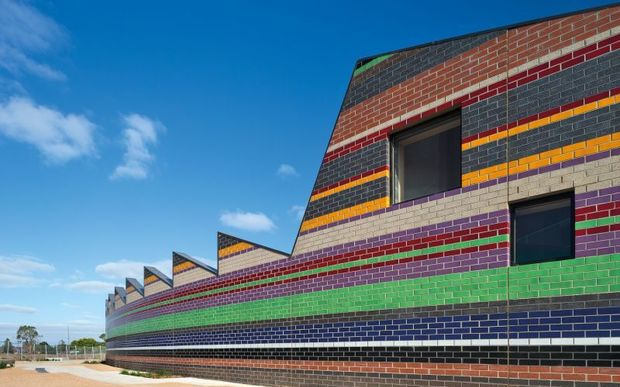 The couple also designed the brightly-coloured Dallas Brooks community primary school.
