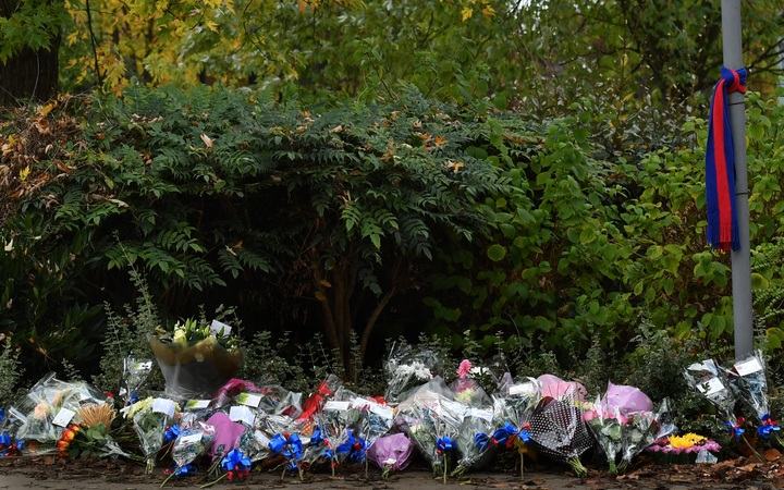 Floral tributes are seen near the scene of a derailed tram in Croydon, south of London. Seven people were killed and around 50 injured  when a London tram came off the tracks and tipped over on November 9, 2016.