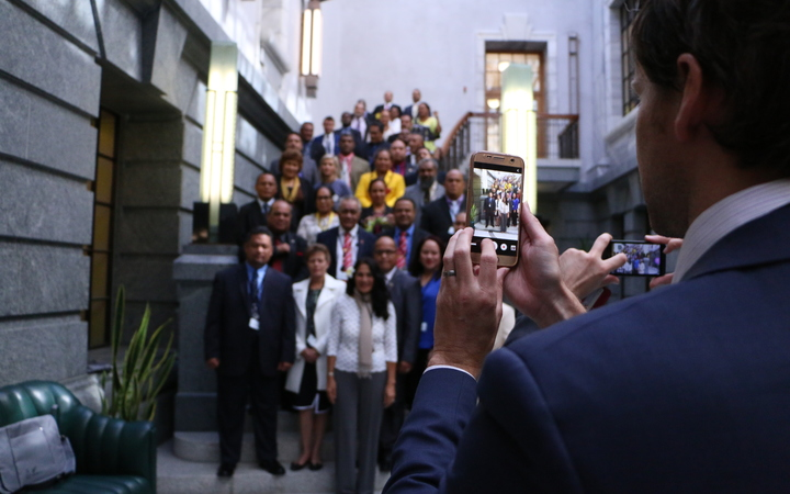 Pacific parliamentarians getting their photo taken in Wellington as part of the Pacific parliamentary forum.