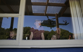 A Defence helicopter nears the home of a Kaikoura Family
