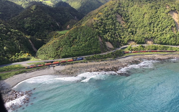 A train is trapped between slips on SH1 after Monday's earthquake.