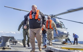 Gerry Brownlee and Tim Keating arrive on the USS Sampson.