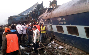 Indian rescue workers search for survivors in the wreckage of the derailed train.