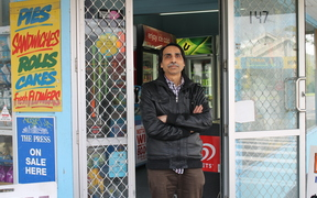 A photo of Kamlesh Patel outside his Opawa dairy. He says he will fight anyone who tries to robs his store