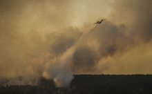 A plane drops water on a forest fire near Ukraine's old Chernobyl nuclear plant.