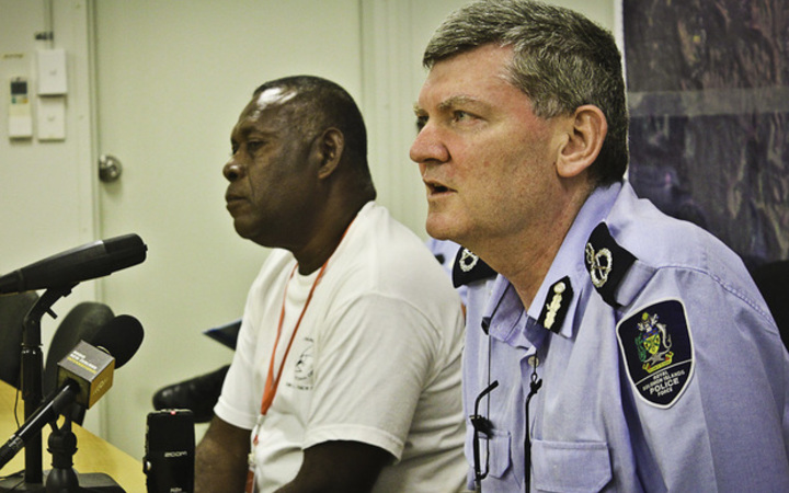 Solomon Islands Police Commissioner Frank Prendergast, (foreground).