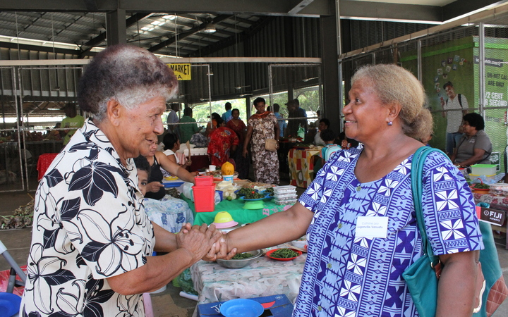Vanuatu's Luganville Municipal Council representative, Catherine Leo, meets Nadi Market Vendor Association President, Lia Lawanamate during the field visit to Nadi Market.18 Nov 2016
