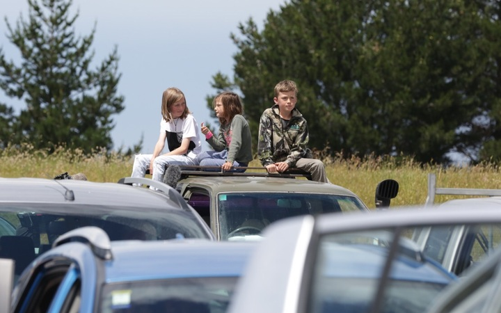 Children waiting at a checkpoint at the start of the inland road out of Kaikoura.
