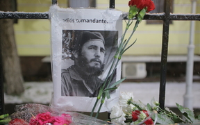 Flowers have been left outside the Cuban Embassy in Moscow after the death of Fidel Castro.