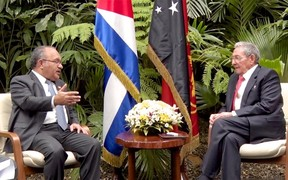 Papua New Guinea Prime Minister Peter O'Neill (left) talks with President of Cuba Raul Castro in Havana.