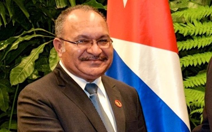 PNG Prime Minister Peter O'Neill (left) extended condolences to Cuba's President Raul Castro (right) on the death of his brother, former Cuban leader Fidel Castro.