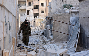 Syrian pro-government forces inspect an area in the Masaken Hanano district in eastern Aleppo, a day after they resized it from rebel fighters.