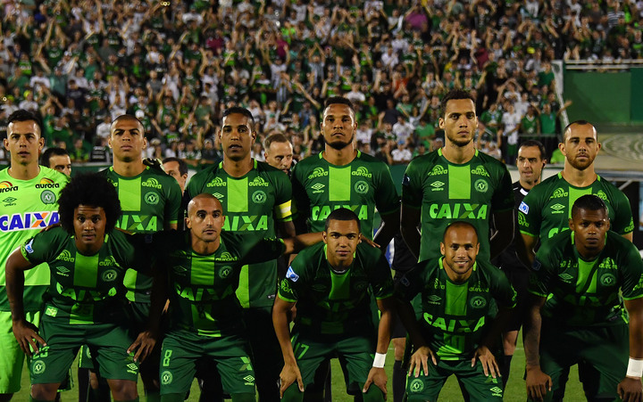 This file photo taken on November 24, 2016 shows Brazil's Chapecoense players posing for pictures during their 2016 Copa Sudamericana semifinal second leg football match against Argentina's San Lorenzo held at Arena Conda stadium, in Chapeco, Brazil.