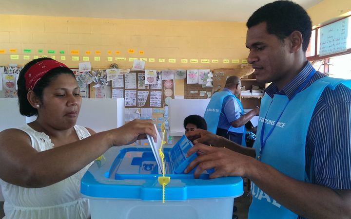 A woman votes in the Fiji elections.