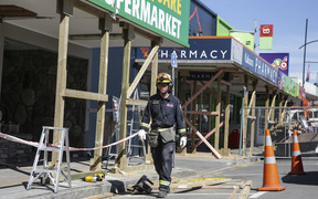 Shops on the main street in Kaikoura have structural work done on them.