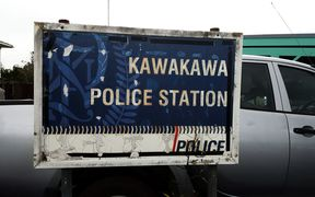"A tatty sign covered in dirt and lichen which says ""Kawakawa Police Station"""
