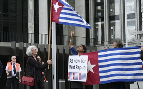 New Zealand MPs participate in a West Papua flag raising event in front of parliament.