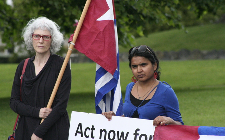 Demonstrators outside New Zealand's parliament at a West Papua flag raising event 2016.