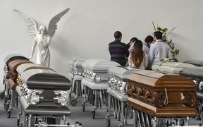 Executives of Chapecoense Real gather around the coffin of one of the team's players killed in plane crash in Colombia.