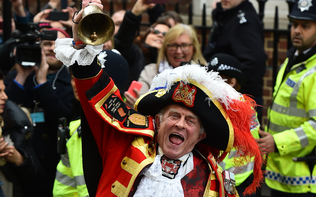 Town crier Tony Appleton makes the announment of the birth.