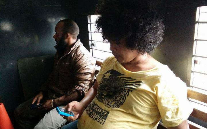 Surya Anta (Spokeperson of FRI West Papua) and AMP leader in police car after arrested