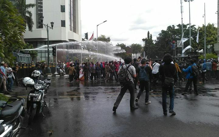 Indonesian police turn water canons on protestors who were mostly university students from Free Papua Organization and the Papua Student Alliance in Jakarta on December 1, 2016.