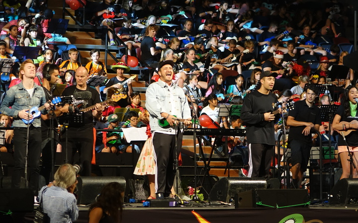 Six60 sing Special with the Kiwileles at the New Zealand Ukulele Festival.
