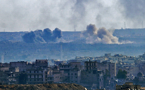 A general view taken from the government-held side of Aleppo shows smoke billowing from the Sheikh Said district during battle between regime forces and rebel fighters on December 3, 2016.