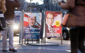Two election placards of the presidential candidates Norbert Hofer (l - FPÖ) and Alexander Van der Bellen stand side-by-side on 03 December 2016 in Vienna, Austria.