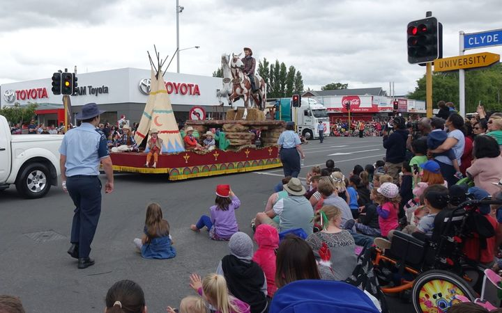 The Ojibwe costumes were removed from the float after complaints, but the cowboys and horses remained.