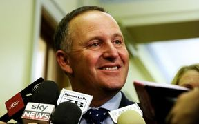 John Key in a media scrum