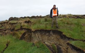 Adrian Benson inspects a land slump.