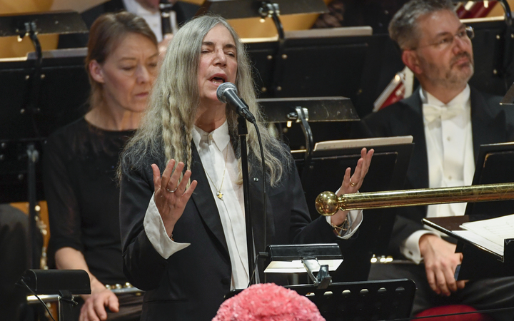 "US singer Patti Smith performs ""A Hard Rain's A-Gonna Fall"" by absent literature prize winner Bob Dylan, at the ceremony in Stockholm."