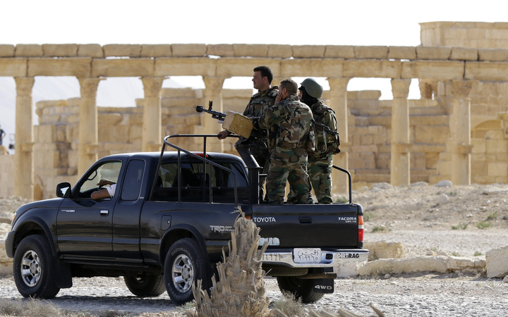 Members of the Syrian army patrol the ancient Syrian city of Palmyra on 6 May 2016.