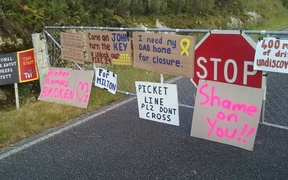 Families of the Pike River dead protest at the sealing of the mine.