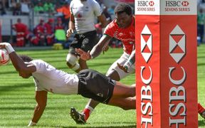 Fiji captain Osea Kolinisau scores against Kenya