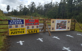 A makeshift checkpoint set up on the road to Pike River Mine by some of the families of the 29 men who died.