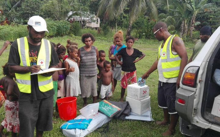 Villagers in Solomon Islands receive relief after a 7.8 magnitude earthquake struck on 9 December 2016