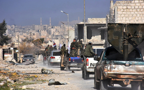 Syrian pro-government forces patrol Aleppo's Sheikh Saeed district, on 12 December, 2016, after troops retook the area from rebel fighters.