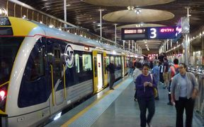 Passengers disembark at Britomart after the first journey on the city's new electric trains.