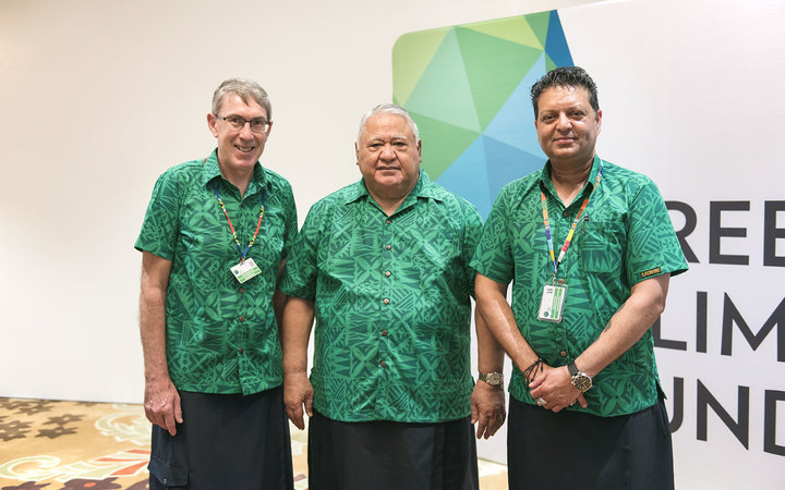 Samoa Prime Minister Tuilaepa Sailele Malielegaoi flanked by GCF Board Meeting Co-chairs (L) Ewen McDonald of Australia and (R) Zahir Fakeer of South Africa.