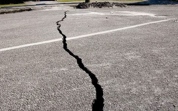 Crack in Christchurch road after earthquakes.