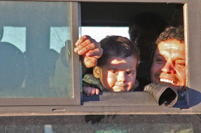 Syrians evacuated from rebel-held neighbourhoods in Aleppo  arrive in the opposition-controlled Khan al-Aassal region, west of the city, on 15 December. Civilians will be taken to  temporary camps on the outskirts of Idlib and the wounded to field hospitals.