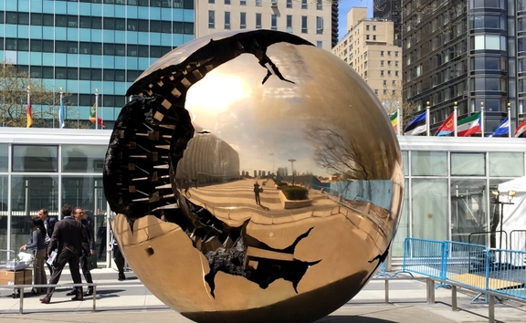 A view of the Sphere Within Sphere sculpture outside the UN General Headquarters in NYC.