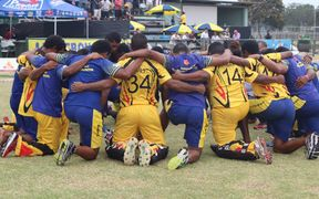 PNG pray following their series win against Namibia.