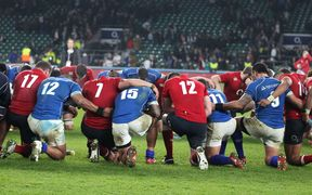 Manu Samoa and England players join for a prayer post-match.