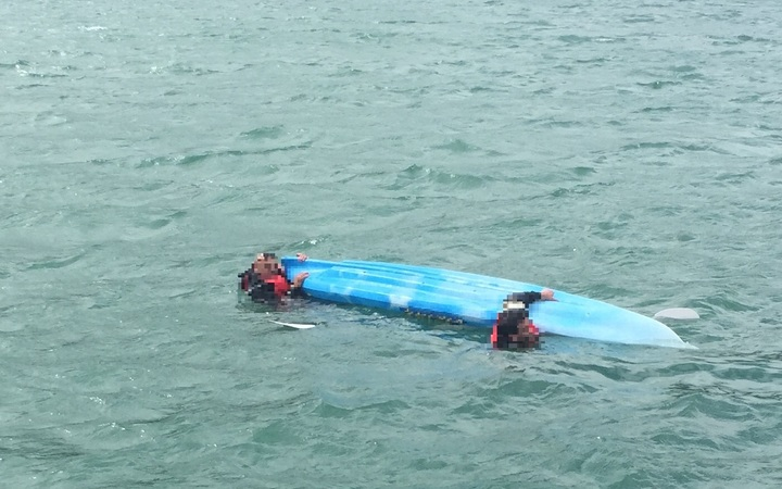 The capsized kayak.