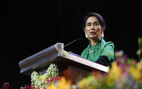 Myanmar State Counsellor Aung San Suu Kyi speaks to the Myanmar Community in Singapore during a meet session on December 1, 2016.